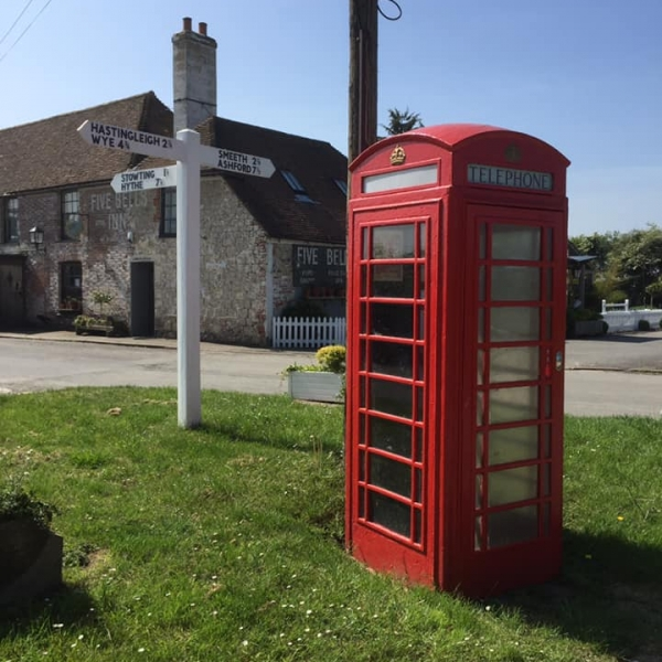Phone box with sign post